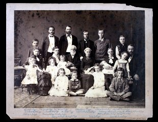 The family of Elias Riggs, who is seated third from left, with Martha beside him.